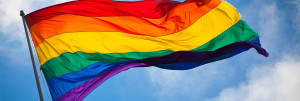 1280px-Rainbow_flag_breeze-1280x430